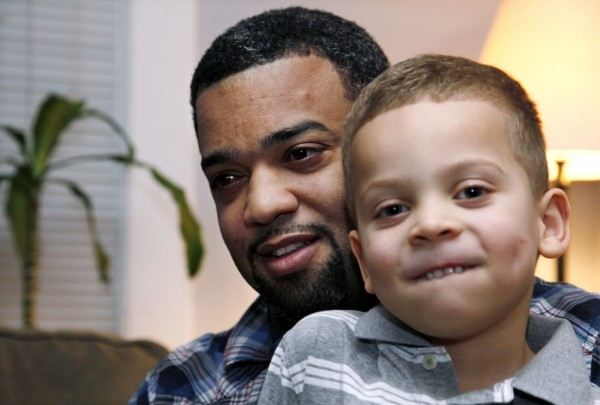 "In this Dec. 27, 2011 photo, Damon Brown sits with his son Julian, 5, at their home in Seattle. Damon Brown found a kidney on Facebook after telling his story on a special page the Seattle dad created under the name, ""Damon Kidney."" His friends and family forwarded the link to everyone they knew and on Jan. 3, a woman his wife has known for years but not someone they consider a close family friend, will be giving him a kidney."
