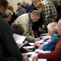Voters sign in on caucus night at Point of Grace Church on Tuesday, Jan. 3, 2012, in Waukee, Iowa.