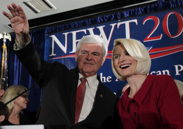 Republican presidential candidate and former House Speaker Newt Gingrich waves to the crowd with his wife Callista during a South Carolina Republican presidential primary night rally, Saturday, Jan. 21, 2012, in Columbia, S.C. Newt Gingrich won the South Carolina primary.