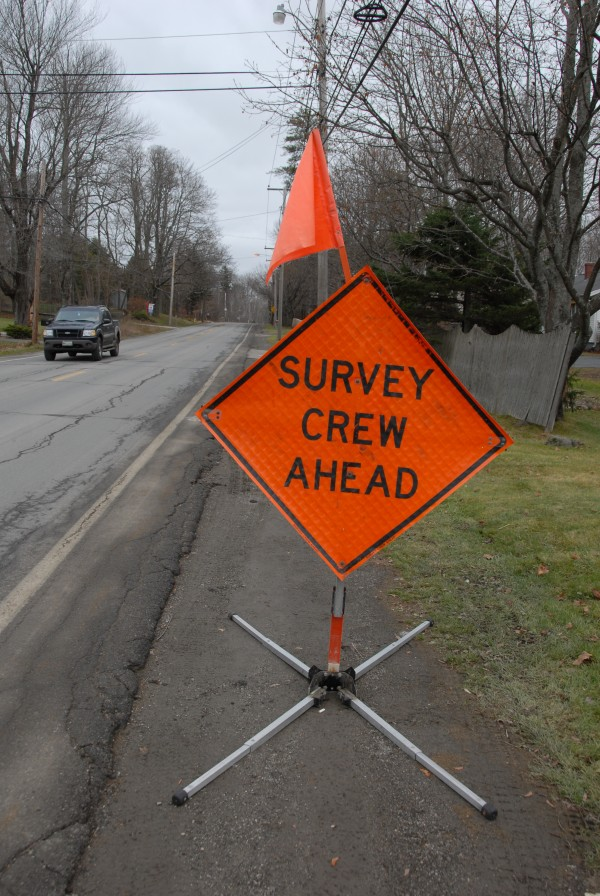 Orange warning signs that frequently appeared along Main Road North in Hampden in November and December were placed there by Maine Department of Transportation surveyors.