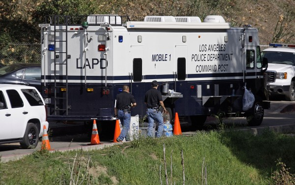 Los Angeles Police investigators are seen at a mobile command post as search operations for more human body parts near an end in Bronson Canyon in the Griffith Park area of Los Angeles Thursday, Jan. 9, 2012.