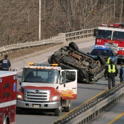 Utility truck rolls over on I-95 in Bangor
