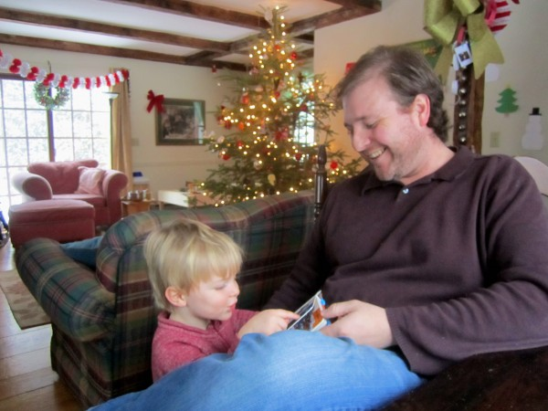 Richard Reinhart, a stay-at-home dad, reads a book with his son Henry.