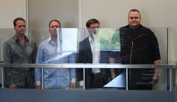Megaupload.com employees Bram van der Kolk, also known as Bramos ( from left); Finn Batato; Mathias Ortmann; and founder, former CEO and current chief innovation officer of Megaupload.com Kim Dotcom, also known as Kim Schmitz and Kim Tim Jim Vestor, appear in North Shore District Court in Auckland, New Zealand on Friday, Jan. 20, 2012. The four appeared in court in relation to arrests made to Megaupload.com, which is linked to a U.S. investigation into international copyright infringement and money laundering.