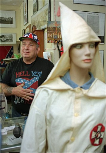 In a Tuesday March 5, 1996 file photo, John Howard, owner of the Redneck Shop in Laurens, S.C. and former KKK grand dragon for the Carolinas, gestures while talking to a reporter. A judge has ruled that the New Beginnings Baptist Church is the rightful owner of the building where The Redneck Shop is located.