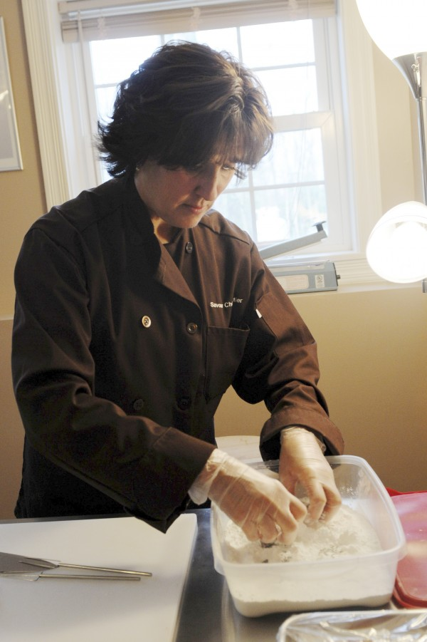 Savour Chocolatier Owner Kim Dagher works on a batch of Bangor Taffy at her businesses kitchen in Veazie. Dagher is a trained chocolatier who studied at the Barry Callebaut Chocolate Academy.