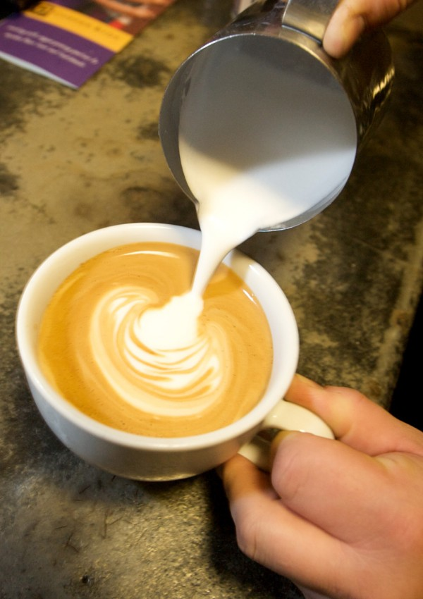 Joshua Davis pours a foamy design on the surface of a latte at the Thursday Night Throwdown at Bard Coffee on Middle Street in Portland Thursday night