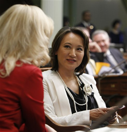 In this file photo from Wednesday, Jan. 4, 2012, Assemblywoman Mary Hayashi, D-Castro Valley, right, talks with her seatmate, Assemblywoman Cathleen Galgiani, D-Livingston, at the Capitol in Sacramento, Calif.  A judge has set a preliminary hearing date for a San Francisco Bay area lawmaker facing a felony shoplifting charge. Hayashi currently faces a felony shoplifting charge for allegedly shoplifting $2,500 worth of merchandise from the San Francisco's Neiman Marcus store.