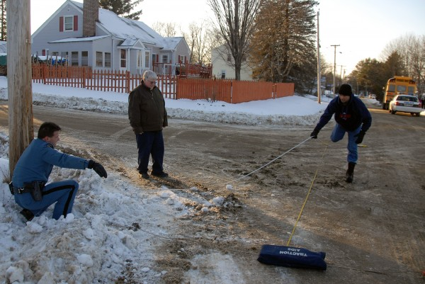 State police Trooper Thomas Fiske (left) and Trooper Larry Anderson take measurements at an accident scene at Ariel and Clark streets in Lincoln on Wednesday, Jan. 18, 2011. Police identified the victim the following day as Sophia Nelson, 6, of Lincoln. Between the two investigators is school bus supervisor Dennis Lowell.