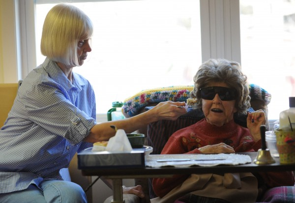 Susan Philbrick (left) feeds her mother Lillan Davis, who is blind, has diabetes and suffers from advanced dementia.