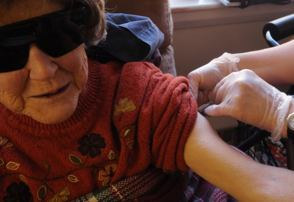 Lillian Davis gets her daily insulin shot on Thursday. Her round-the-clock health care costs $10,000 a month.
