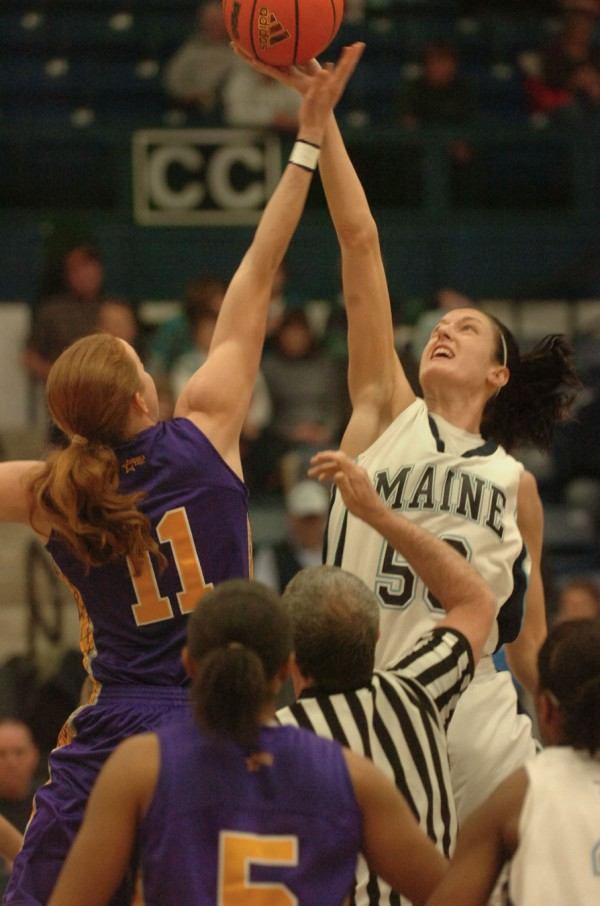 University at Albany's Julie Forster (left) and the University of Maine's Samantha Baranowski tip off at the start of their America East basketball game at Alfond Arena in Orono, Saturday afternoon, Jan. 14, 2012. The Great Dane's outlasted the Lady Black Bears 60-48.