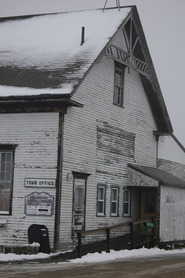 Town officials in the Washington County community of Milbridge will decide Saturday, Jan. 14, on moving forward with plans to demolish the existing century-old building that now houses the town office and public library. The proposal would include constructing a new, $600,000 building where the adjacent Town Hall is now located.