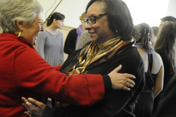 Phyllis Brazee (left), professor emerita of education at the University of Maine, greets Dr. Denise Patmon  while gathering with others for the 16th annual Martin Luther King Jr. Breakfast at the University of Maine in Orono Monday, Jan. 16, 2012. Dr. Patmon is the director of the undergraduate teacher licensure program at UMass Boston and faculty advisor of the Boston Writing Project.
