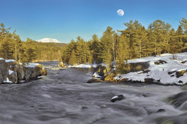 This dramatic shot of Katahdin, the West Branch of the Penobscot and the full moon taken at the Cribworks is just one of Picard's winter photos available at Moose Prints Gallery and Gifts, 58 Central St., Millinocket.