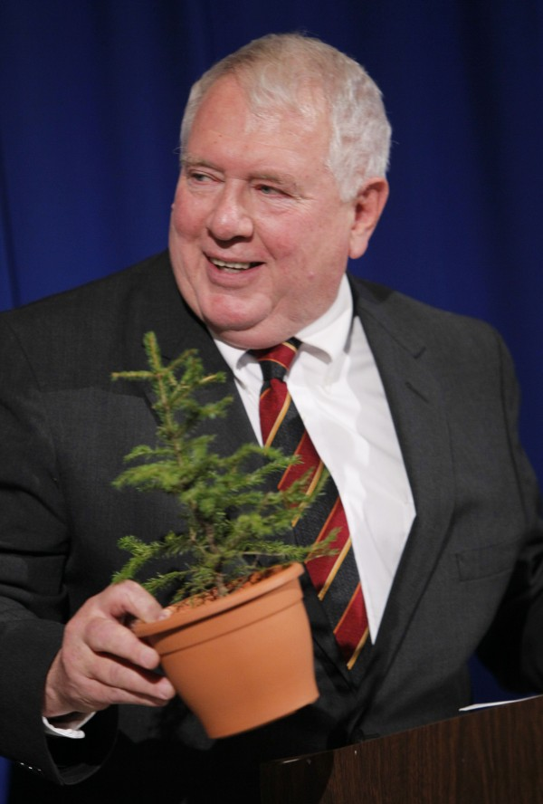 William Beardsley holds a spruce tree while speaking at a news conference after being nominated to head the Department of Conservation at the State House in December 2010.