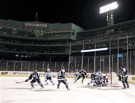 Maine and New Hampshire players battle for a loose puck in front of the net during the first period of an NCAA college hockey game at Fenway Park in Boston, Saturday, Jan. 7, 2012.