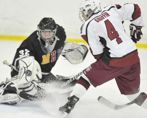 Maranacook goalie Tyler Plante (32) makes a pad save on a shot by Bangor forward Connor Griffin (4) in the second period of their game in Bangor on Wednesday, Jan. 25, 2012.