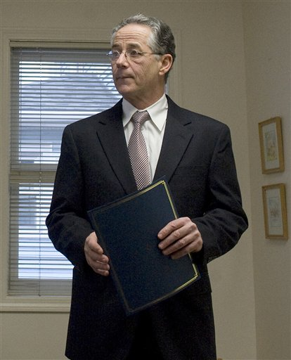 East Haven Mayor Joseph Maturo Jr. delivers a proclamation to an employee in East Haven, Conn., Thursday, Jan. 26, 2012.  Maturo has expressed remorse for saying he &quotmight have tacos&quot to do something for his town's besieged Latino community — but he has no plans to step down.