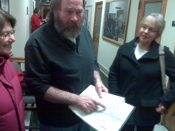 Brewer resident Larry Adams points to a map for the proposed Interstate 395-Route 9 connector that passes through his backyard after the Tuesday, Jan. 10, 2012, Brewer City Council meeting. He is flanked by neighbors Jane Hinckley (right) and Carol Smith (left).
