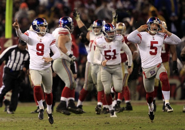 New York Giants kicker Lawrence Tynes (9) and punter Steve Weatherford (5) celebrate after Tynes kicked the game winning field goal during overtime of the NFC Championship NFL football game Sunday, Jan. 22, 2012, in San Francisco. The Giants won 20-17 to advance to Super Bowl XLVI.