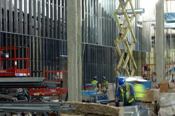 The interior of the Oxford casino is under construction, with wall frames already up and an electrical grid installed in the floor. The building is heated, and dozens of workers from several Maine firms were involved in the construction on Thursday.