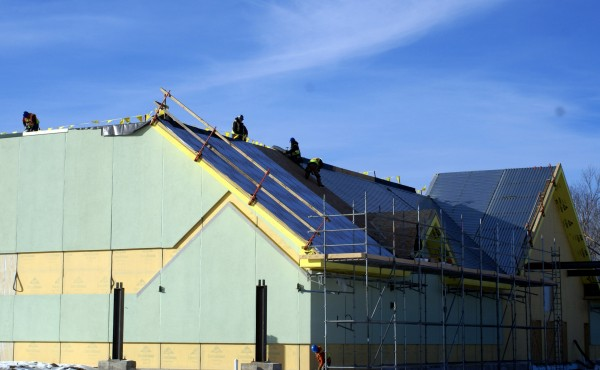 Workers from Hahnel Bros. Co. of Lewiston work of the roof of the Oxford Casino on Thursday. Community Development Director Scott Smith said construction is on schedule thanks to a mild December.