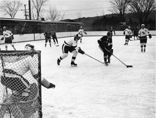 The 1965 photograph shows Hebron Academy playing a New Hampshire ice hockey team on the outdoor artificial ice rink. It was built after the collapse of the second Stanley Arena due to heavy snow on the roof in 1960.