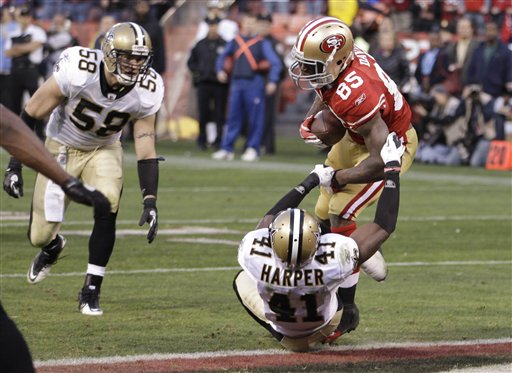 San Francisco 49ers tight end Vernon Davis (85) scores on a 14-yard touchdown pass from quarterback Alex Smith over New Orleans Saints strong safety Roman Harper (41) with nine seconds left in the fourth quarter of an NFL divisional playoff game Saturday night, Jan. 14, 2012, in San Francisco.