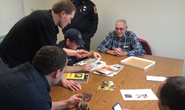 On Tuesday, Jan. 10, 2012, members of the Orono Fire Department search through a box of old photographs for pictures of former fire Chief Lorin Lecleire, who passed away on Monday, Jan. 9, 2012, at age 52. Stories of the former chief were the topic of the day for Orono's firefighters and paramedics.
