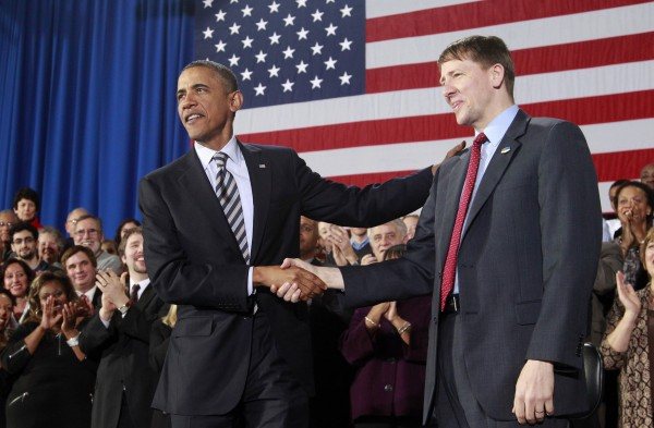 President Barack Obama shakes hands with Richard Cordray before speaking about the economy, Wednesday, Jan. 4, 2012, at Shaker Heights High School in Shaker Heights, Ohio.
