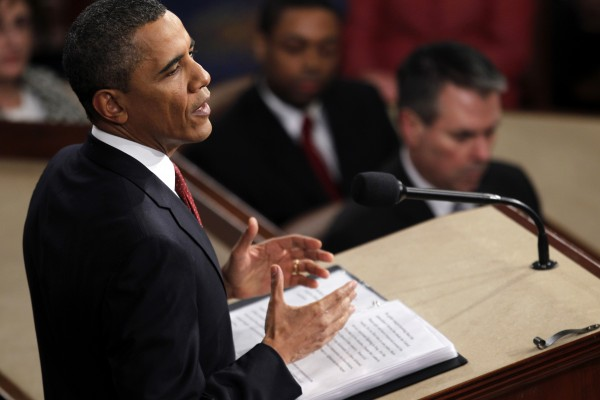 President Barack Obama gestures while giving his State of the Union address on Capitol in Washington on Tuesday, Jan. 24, 2012.