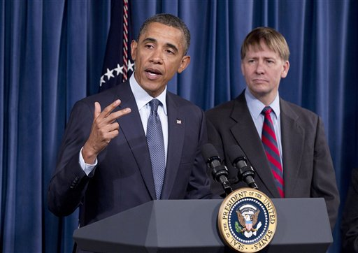 President Barack Obama visits the new director of the Consumer Financial Protection Bureau, Richard Cordray, right, Friday, Jan. 6, 2012, at the CFPB's offices in Washington. (AP Photo/J. Scott Applewhite)