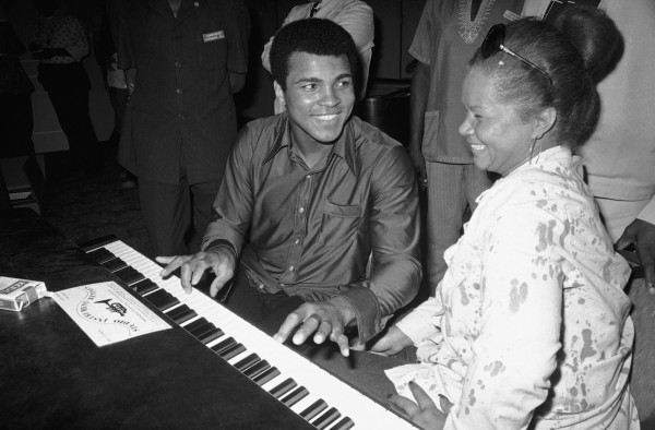 Muhammad Ali plays a few notes on the piano as singer Etta James looks on in September 1974.