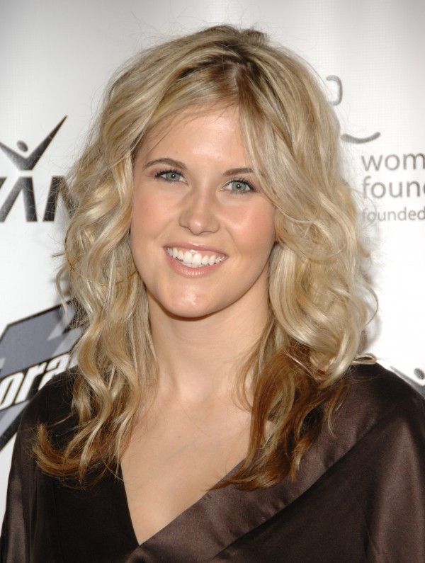 In this Oct. 15, 2007, file photo, honoree Sarah Burke arrives at the Women's Sports Foundation's 28th Annual Salute to Women in Sports at the Waldorf-Astoria Hotel in New York. Burke died Thursday, Jan. 19, 2012, nine days after crashing at the bottom of the superpipe during a training run in Utah. She was 29.