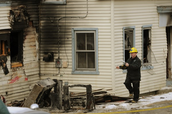 Maine State Fire Marshal investigator Ed Archer measures the house located at 527 Dow Road in Orrington on Tuesday, Jan 31, 2012 during his investigation of a blaze at that location. The fire was reported at 7:15 p.m. Monday, Jan 30, 2012.