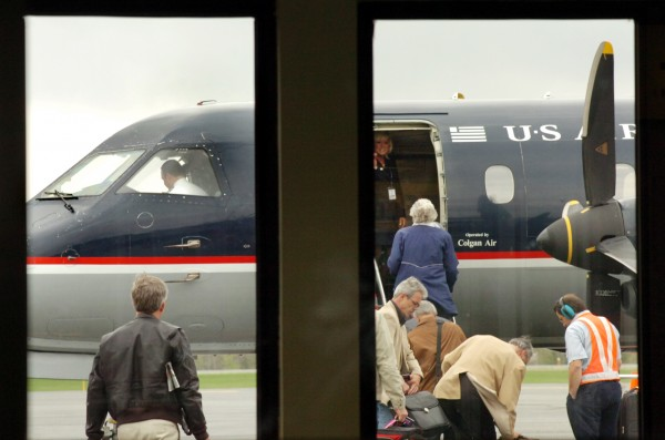 Passengers board a morning US Airways flight bound to Boston at Northern Maine Regional Airport in Presque Isle in 2008. Starting March 25, US Airways will offer daily nonstop flights between Bangor International Airport and Reagan National Airport in Washington, D.C., as well as additional nonstop flights between Bangor and Philadelphia.