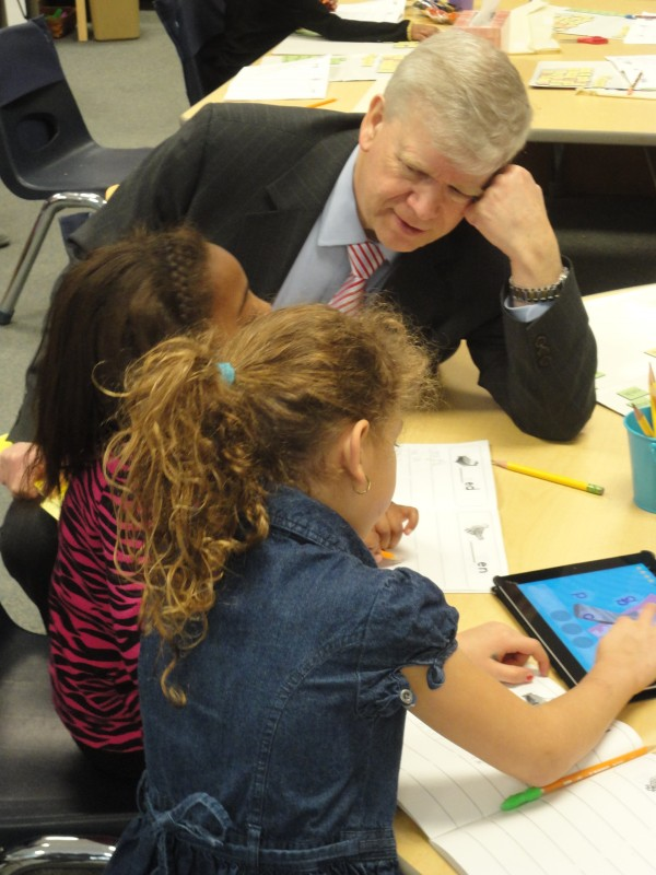 Jo Anderson, senior adviser to U.S. Education Secretary Arne Duncan, sits with two students at Riverton Community School in Portland Tuesday morning, Jan. 31, 2012. Anderson was scheduled to spend the day in Portland schools visiting with administrators and faculty members to learn about ways the city schools were using federal aid and collaborations between the district and teachers' union.