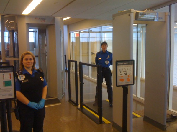 Transportation Security Administration officers stand guard Monday morning during the federal organization's public unveiling of new advanced imaging technology at Portland International Jetport.