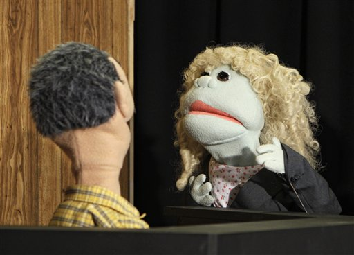 A puppet representing defense attorney Andrea Whitaker cross-examines a Ferris Kleem puppet during taping at WOIO-TV in Cleveland Thursday, Jan. 19, 2012. The station uses the puppets performing as witnesses, reporters and jurors to detail the corruption trial against former Cuyahoga county commissioner Jimmy Dimora, which began last week in federal court in Akron.