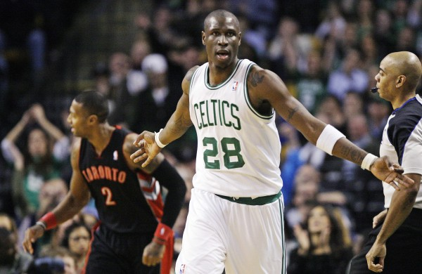 Boston Celtics forward Mickael Pietrus (28) reacts after hitting a 3-pointer against Toronto Raptors forward James Johnson (2) in the second half of an NBA basketball game in Boston, Wednesday, Jan. 18, 2012. The Celtics won 96-73.