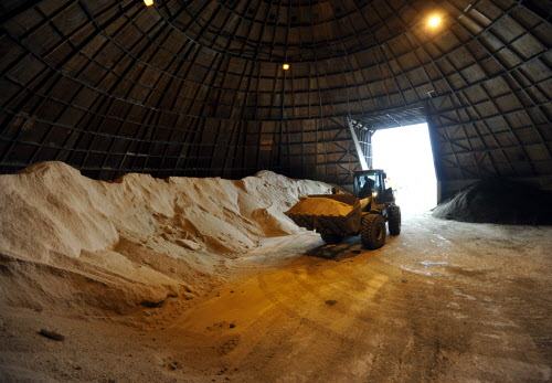 Jimmy McLaughlin, yard loader for the City of Bangor Public Works on Maine Avenue, gets a load of salt from the salt shed to fill a truck during the snowfall on Tuesday, Jan. 17, 2012.