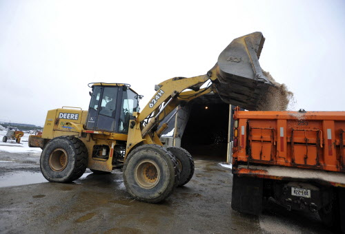 Jimmy McLaughlin, yard loader for the City of Bangor Public Works on Maine Avenue, fills a salt truck during the snowfall on Tuesday, Jan. 17, 2012.
