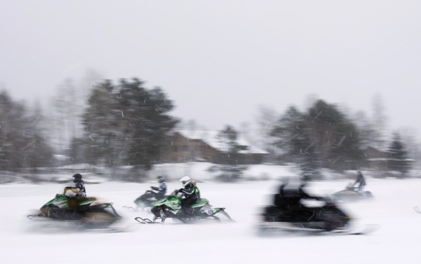 Snowmobilers ride across Rangeley Lake during the Snodeo, Saturday, Jan. 21, 2012, in Rangeley, Maine.