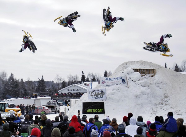 A composite photo captures the stages of a back flip performed by Kourtney Hungerford during the Rave X freestyle show at the Snodeo, Saturday, Jan. 21, 2012, in Rangeley, Maine.