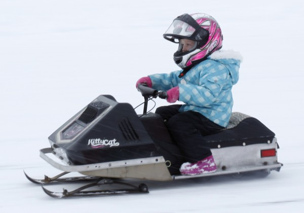 Riley Small, 4, of Livermore, Maine, races across Rangeley Lake during the Radar Run at the Snodeo, Saturday, Jan. 21, 2012, in Rangeley, Maine. Small's Arctic Kitty sled hit a speed of 7.2 mph.