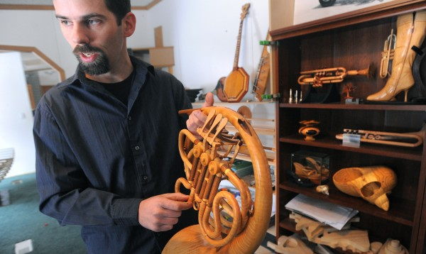 Rob Jones, 37, of Thomaston talks about the instrument he made out of wood over the past 10 years. Jones eventually made some that are completely functional.