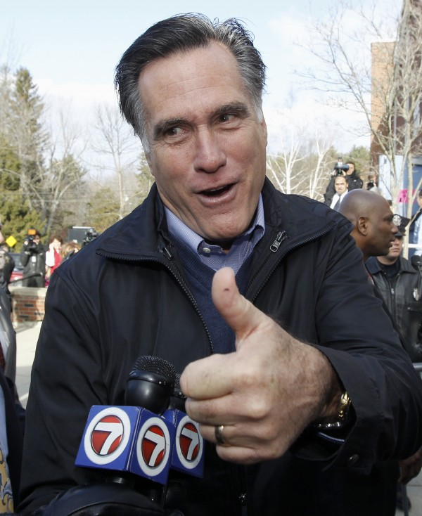 Republican presidential candidate former Massachusetts Gov. Mitt Romney gives a thumbs up as he campaigns on primary election day outside of a polling station at Webster School in Manchester, N.H., Tuesday, Jan. 10, 2012.