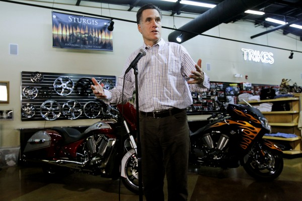 Republican presidential candidate former Massachusetts Gov. Mitt Romney speaks to reporters after he campaigned at Cherokee Trike and More in Greer, S.C., Thursday, Jan. 12, 2012.