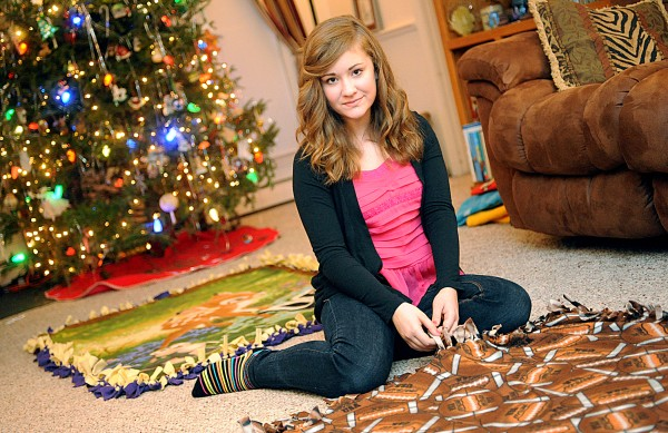 Molly McCormick, 12, pauses while working on a blanket for Project Linus, a national organization that gathers blankets for children in need. The seventh-grader from Turner has a reputation for fundraising, garnering $8,500 in donations for various causes in the past two years.
